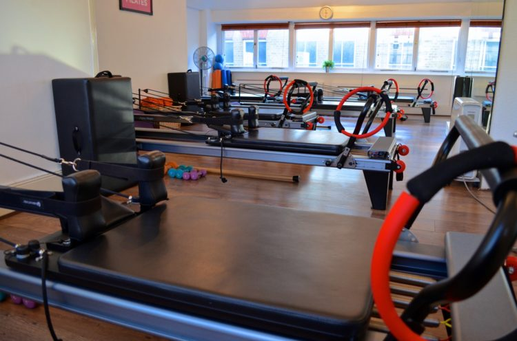 What Are the Benefits of Reformer Pilates Over Mat Pilates?